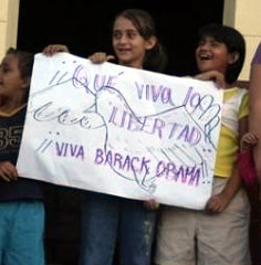 Carasque kids with sign